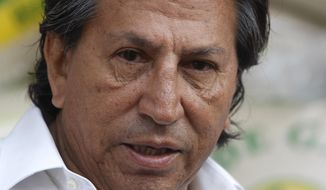 FILE - In this March 17, 2011 file photo, Peru's former President Alejandro Toledo campaigns for reelection at the Santa Anita wholesale market in Lima, Peru. Peruvian authorities said they searched Toledo's house on Saturday, Feb. 4, 2017 in a case involving alleged bribes from a construction firm under investigation in a major corruption probe in Brazil. Toledo currently is in Paris and denied the charges by telephone to Peruvian media. (AP Photo/Karel Navarro, File)