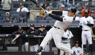 FILE - In this Oct. 2, 2016 file photo, New York Yankees' Mark Teixeira grounds out at bat against the Baltimore Orioles in the second inning of a baseball game, in New York. Teixeira will work as an ESPN analyst following his retirement as a player. ESPN said Tuesday, Feb. 7, 2017,  it had reached a multiyear agreement with the three-time All-Star first baseman.  (AP Photo/Kathy Kmonicek, File)