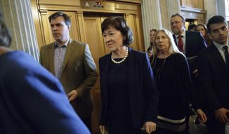 Sen. Susan Collins, R-Maine, center, who defected from the GOP majority, arrives at the Senate chamber on Capitol Hill in Washington, Tuesday, Feb. 7, 2017, as the Senate voted for Education Secretary-designate Betsy DeVos,. ice President Mike Pence was needed to cast the tie-breaking vote to confirm DeVos. (AP Photo/J. Scott Applewhite)