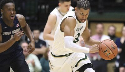 Colorado State guard Gian Clavell, right, drives after stealing the ball during an NCAA college basketball game against Utah State, Tuesday Feb. 7, 2017, at Moby Arena in Fort Collins, Colo. (Brian Smith/Fort Collins Coloradoan via AP)