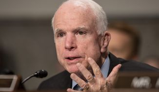 Sen. John McCain has broken with President Trump on a number of issues, but he insists he's 100 percent on board regarding military plans. (Associated Press) ** FILE **
