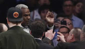 Former New York Knicks player Charles Oakley exchanges words with a security guard during the first half of an NBA basketball game between the New York Knicks and the LA Clippers Wednesday, Feb. 8, 2017, in New York. (AP Photo/Frank Franklin II)  **FILE**