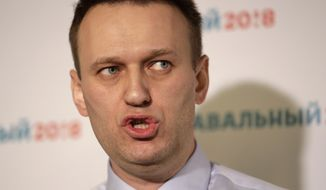 Russian opposition leader Alexei Navalny speaks at a news conference in his campaign office in St. Petersburg, Russia, in this Saturday, Feb. 4, 2017, file photo. (AP Photo/Elena Ignatyeva, file)