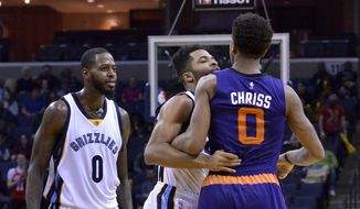Memphis Grizzlies guard Andrew Harrison, center, gets between Phoenix Suns forward Marquese Chriss (0) and Grizzlies forward JaMychal Green, left, during an altercation on the court in the second half of an NBA basketball game Wednesday, Feb. 8, 2017, in Memphis, Tenn. (AP Photo/Brandon Dill)