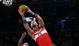 Washington Wizards center Marcin Gortat (13) shoots as Brooklyn Nets guard Randy Foye (2) defends during the first half of an NBA basketball game, Wednesday, Feb. 8, 2017, in New York. (AP Photo/Kathy Willens)