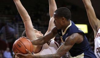 Pittsburgh guard Justice Kithcart looks to pass as Boston College center Johncarlos Reyes defends during the first half of an NCAA college basketball game Wednesday, Feb. 8, 2017, in Boston. (Barry Chin/The Boston Globe via AP)