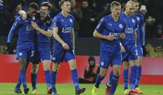 Leicester's players celebrate the goal of Demarai Gray, left, during the English FA Cup Fourth Round replay soccer match between Leicester City and Derby County at the King Power Stadium in Leicester, England, Wednesday, Feb. 8, 2017. (AP Photo/Rui Vieira)