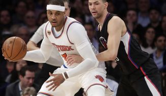 LA Clippers' Austin Rivers (25) defends New York Knicks' Carmelo Anthony (7) during the first half of an NBA basketball game, Wednesday, Feb. 8, 2017, in New York. (AP Photo/Frank Franklin II)