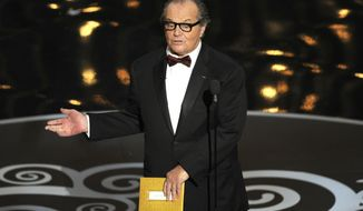 "FILE - In this Feb. 24, 2013 file photo, Jack Nicholson speaks onstage during the Oscars at the Dolby Theatre in Los Angeles. After a seven year hiatus from film, Nicholson is expected to return to the big screen in an English language remake of the Oscar-nominated German comedy ""Toni Erdmann."" Nicholson and Kristen Wiig are attached to star according to a person close to the production who requested anonymity because he/she wasn't authorized to speak about the project. The trade publication Variety first reported the news Tuesday, Feb. 7, 2017. (Photo by Chris Pizzello/Invision/AP, File)"