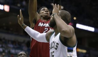 Miami Heat's Hassan Whiteside(21) drives against the Milwaukee Bucks' Greg Monroe, right, during the first half of an NBA basketball game Wednesday, Feb. 8, 2017, in Milwaukee. (AP Photo/Jeffrey Phelps)