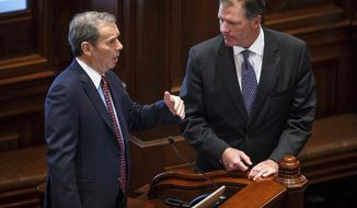 Illinois Senate President John Cullerton, D-Chicago, left, talks with State Sen. Bill Brady, R-Bloomington, after Senate Bill 11, the pension reform bill, failed by a vote of 18-29, with 10 present votes, on the Senate floor at the Illinois State Capitol, Wednesday, Feb. 8, 2017, in Springfield, Ill. The Illinois Senate's attempt Wednesday to bust open a longstanding budget stalemate did not bode well for ending the nation's longest state-budget drought since World War II. (Justin L. Fowler/The State Journal-Register via AP)