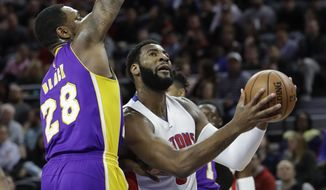 Detroit Pistons center Andre Drummond, right, drives on Los Angeles Lakers center Tarik Black (28) during the first half of an NBA basketball game, Wednesday, Feb. 8, 2017, in Auburn Hills, Mich. (AP Photo/Carlos Osorio)