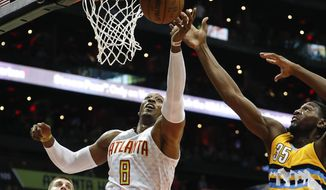 Atlanta Hawks center Dwight Howard (8) and Denver Nuggets forward Kenneth Faried (35) battle for a rebound during the first half of an NBA basketball game Wednesday, Feb. 8, 2017, in Atlanta. (AP Photo/John Bazemore)