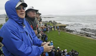 Spectators watch Daniel Lawrence Whitney, better known as, Larry the Cable Guy, hit from the 18th tee during the celebrity challenge event of the AT&T Pebble Beach National Pro-Am golf tournament Wednesday, Feb. 8, 2017, in Pebble Beach, Calif. (AP Photo/Eric Risberg)