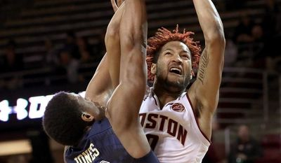 Boston College guard Ky Bowman (0) puts up a shot as Pittsburgh guard Chris Jones (12) defends during the first half of an NCAA college basketball game Wednesday, Feb. 8, 2017, in Boston. (Barry Chin/The Boston Globe via AP)