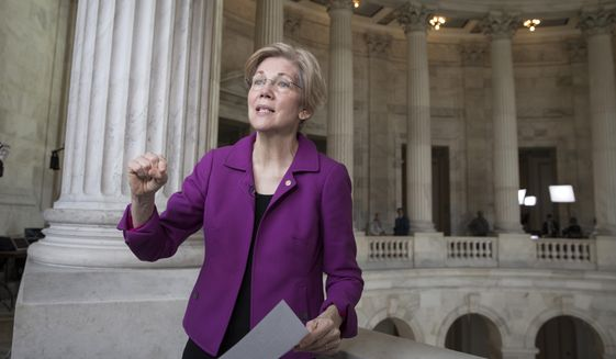 Sen. Elizabeth Warren, D-Mass. reacts to being rebuked by the Senate leadership and accused of impugning a fellow senator, Attorney General-designate, Sen. Jeff Sessions, R-Ala., in this Wednesday, Feb. 8, 2017, file photo, on Capitol Hill in Washington Warren was barred from saying anything more on the Senate floor about Sessions after she quoted from an old letter from Martin Luther King Jr.'s widow about Sessions. (AP Photo/J. Scott Applewhite) ** FILE **