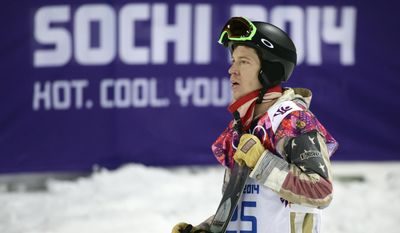 FILE - In this Feb. 11, 2014, file photo, Shaun White, of the United States, looks at the scoreboard after competing in the men's snowboard halfpipe final at the Rosa Khutor Extreme Park, at the 2014 Winter Olympics in Krasnaya Polyana, Russia. The next Olympics are still a year away, and already, Shaun White is thinking about the games after that. The Summer Games, that is. The world's best-known snowboarder tells The Associated Press he's exploring competing in Tokyo in skateboarding, which will be added to the program for 2020.  (AP Photo/Jae C. Hong, File)
