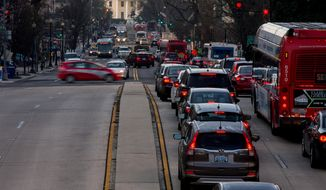The White House is visible as morning traffic builds along 16th Street Northwest, in Washington, Wednesday, March 16, 2016. The Metro subway system that serves the nation's capital and its Virginia and Maryland suburbs shut down for a full-day for an emergency safety inspection of its third-rail power cables. Making for unusual commute, as the lack of service is forcing some people on the roads, while others are staying home or teleworking. (AP Photo/Andrew Harnik)