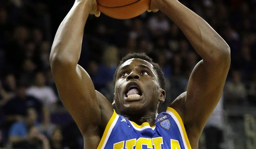 Ucla S Aaron Holiday Begins His Leap To The Basket For A