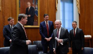 After being sworn in on Thursday, Attorney General Jeff Sessions (second from right) met with (from left) U.S. Marshall Acting Director David Harlow, DEA Acting Administrator Chuck Rosenberg, FBI Director James Comey, and Attorney General Chief of Staff Jody Hunt at the Department of Justice. (Associated Press)