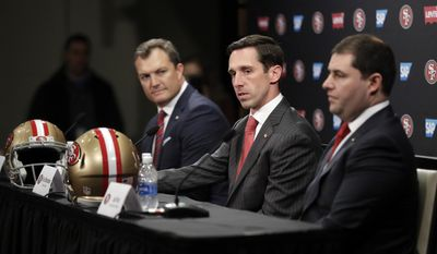 San Francisco 49ers head coach Kyle Shanahan, center, answers questions next to general manager John Lynch, left, and owner Jed York during an NFL football press conference Thursday, Feb. 9, 2017, in Santa Clara, Calif. (AP Photo/Marcio Jose Sanchez)
