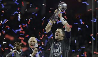 New England Patriots' Tom Brady, right, celebrates with the Vince Lombardi Trophy next to broadcaster Terry Bradshaw after the NFL Super Bowl 51 football game against the Atlanta Falcons Sunday, Feb. 5, 2017, in Houston. (AP Photo/Elise Amendola)