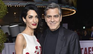 "Amal Clooney, left, and George Clooney arrive at the world premiere of ""Hail, Caesar!"" in Los Angeles, Feb. 1, 2016. (Associated Press) ** FILE **"
