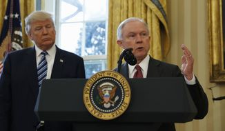 President Donald Trump listens as Attorney General Jeff Sessions speaks in the Oval Office of the White House in Washington, after Vice President Mike Pence administered the oath of office to Sessions. (AP Photo/Pablo Martinez Monsivais)