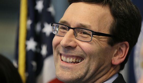 Washington Attorney General Bob Ferguson smiles at a news conference about a federal appeals court's refusal to reinstate President Trump's ban on travelers from seven predominantly Muslim nations. (Associated Press)