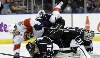 Florida Panthers center Jonathan Marchessault, left, collides with Los Angeles Kings goalie Peter Budaj (31) and Paul LaDue (38) during the second period of an NHL hockey game, Thursday, Feb. 9, 2017, in Sunrise, Fla. (AP Photo/Lynne Sladky)