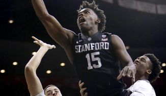 Stanford guard Marcus Allen (15) drives between Arizona's Chance Comanche, left, and Kobi Simmons during the first half of an NCAA college basketball game, Wednesday, Feb. 8, 2017, in Tucson, Ariz. (AP Photo/Rick Scuteri)