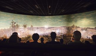FILE - In this Tuesday, June 30, 2015, file photo, visitors view the Atlanta Cyclorama, the colossal Civil War painting in Atlanta. The painting depicting the Battle of Atlanta from the American Civil War will soon be moved from the building where it has been displayed for nearly a century. Historians said moving the 6-ton Cyclorama, one of the nation's largest paintings, from Grant Park to the Atlanta History Center across town marks a major milestone in its restoration. The move is to begin Thursday, Feb. 9, 2017. (AP Photo/David Goldman, File)