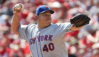 FILE - In this Sept. 5, 2016, file photo, New York Mets starting pitcher Bartolo Colon throws in the second inning of a baseball game against the Cincinnati Reds in Cincinnati. A pair of 40-something right-handers, Colon and R.A. Dickey, were signed as placeholders for the Atlanta Braves' wave of young starting pitchers that are left to compete for one or two spots in the rotation when spring training begins next week.  (AP Photo/John Minchillo, File)