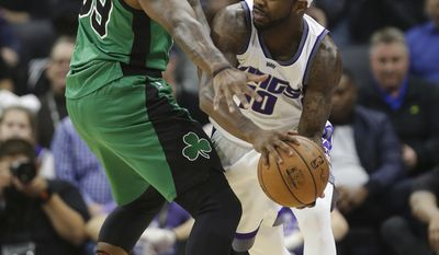 Sacramento Kings guard Ty Lawson, right, looks to pass against Boston Celtics forward Jae Crowder during the first quarter of an NBA basketball game, Wednesday, Feb. 8, 2017, in Sacramento, Calif. (AP Photo/Rich Pedroncelli)