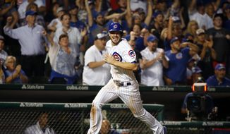 FILE - In this July 7, 2016, file photo, Chicago Cubs' Kris Bryant scores on a single hit by Ben Zobrist during the eighth inning of a baseball game against the Atlanta Braves, in Chicago. Bryant is back. Same for Anthony Rizzo and Jon Lester, too. Even 1908 is back in the picture.  That was the last time the Chicago Cubs won the World Series before Bryant and company ended the drought last November. (AP Photo/Nam Y. Huh, File)