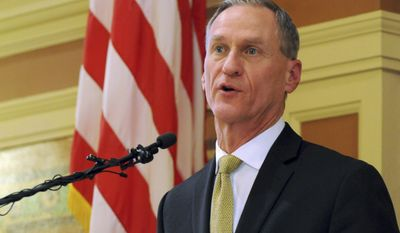 """FILE - In this Jan. 12, 2016, file photo, South Dakota Gov. Dennis Daugaard speaks at the state Capitol in Pierre, S.D. Daugaard threatened Thursday Feb. 9, 2017 to veto bills that would allow guns in the state Capitol and let people carry concealed handguns without a permit if they are approved by the Legislature. The Republican governor praised South Dakota's """"reasonable"""" gun laws, saying that some states are much more restrictive. Daugaard's position is a steep obstacle for lawmakers pushing the bills. (AP Photo/James Nord, File)"""