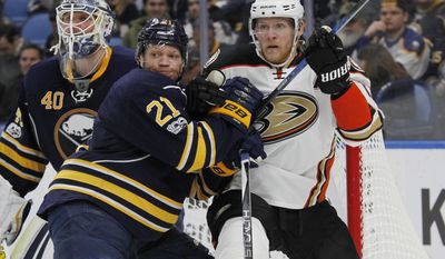Buffalo Sabres Kyle Okposo (21) and Anaheim Ducks Corey Perry (10) battle for position during the second period of an NHL hockey game, Thursday, Feb. 9, 2017, in Buffalo, N.Y. (AP Photo/Jeffrey T. Barnes)
