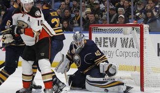 Buffalo Sabres goalie Robin Lehner (40) makes a save on Anaheim Ducks forward Corey Perry (10) during the second period of an NHL hockey game, Thursday, Feb. 9, 2017, in Buffalo, N.Y. (AP Photo/Jeffrey T. Barnes)