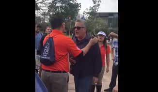 A faculty member at California State University, Fullerton is accused of hitting a College Republicans member during an otherwise peaceful demonstration between pro-Palestine students and counter protesters. (The Daily Titan)