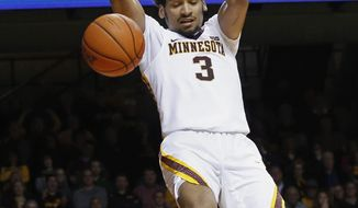 Minnesota's Jordan Murphy dunks against Iowa during the second half of an NCAA college basketball game Wednesday, Feb. 8, 2017, in Minneapolis. Murphy scored 25 points as Minnesota won 101-89 in two overtimes. (AP Photo/Jim Mone)