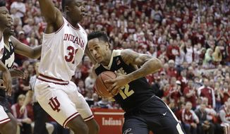 Purdue's Vince Edwards goes to the basket against Indiana's Thomas Bryant during the first half of an NCAA college basketball game Thursday, Feb. 9, 2017, in Bloomington, Ind. (AP Photo/Darron Cummings)