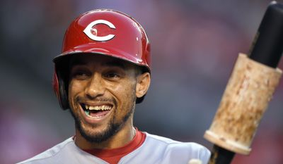 FILE - In this Aug. 30, 2016, file photo, Cincinnati Reds' Billy Hamilton smiles as he gets ready to bat during the first inning of a baseball game against the Los Angeles Angels, Tuesday, Aug. 30, 2016, in Anaheim, Calif. Cincinnati invested most of its offseason spending on a bullpen that was one of the worst in major league history. With an everyday lineup anchored by Billy Hamilton and Joey Votto, they have enough offense to keep up. (AP Photo/Mark J. Terrill, File)