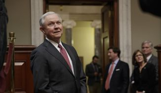 New Attorney General Jeff Sessions watches from the background as his Senate replacement Sen. Luther Strange, R-Ala., is welcomed at a ceremony on Capitol Hill in Washington, Thursday, Feb. 9, 2017. (AP Photo/J. Scott Applewhite)