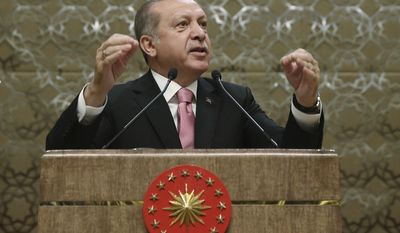 Turkey's President Recep Tayyip Erdogan addresses local administrators after the government has sacked nearly 4,500 more state employees, including academicians, as it appeared to press ahead with a purge of people with suspected links to a U.S.-based cleric accused of orchestrating a failed military coup, in Ankara, Turkey, Wednesday, Feb. 8, 2017. .(YasinBulbul/Pool photo via AP)