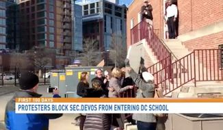 Protesters physically blocked newly confirmed Education Secretary Betsy DeVos from entering a Washington, D.C., public school Friday morning. (WJLA)