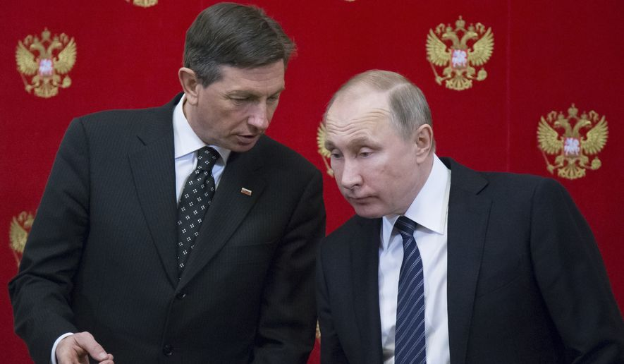 Russian President Vladimir Putin, right, listens to Slovenian President Borut Pahor after a signing ceremony following their talks at the Kremlin in Moscow, Russia, Friday, Feb. 10, 2017. Slovenia's ambassador to Moscow told RIA Novosti news agency that his country could host the first meeting between President Donald Trump and Russian President Vladimir Putin. (AP Photo/Alexander Zemlianichenko, pool)