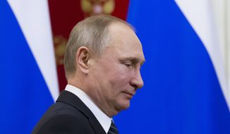 Russian President Vladimir Putin leaves a news conference with Slovenian President Borut Pahor after their talks at the Kremlin in Moscow, Russia, Friday, Feb. 10, 2017. Putin thanked Slovenia Friday for offering to host his first meeting with U.S. President Donald Trump, but added that the prospect hinges on Washington. (AP Photo/Alexander Zemlianichenko, pool)