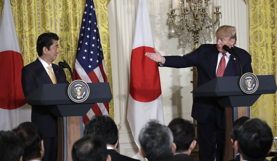 President Donald Trump gestures toward Japanese Prime Minister Shinzo Abe during their joint news conference in the East Room of the White House in Washington, Friday, Feb. 10, 2017.  (AP Photo/Evan Vucci)