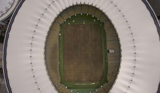 This Feb. 2, 2017 photo shows Maracana stadium's dry playing field in Rio de Janeiro, Brazil. The stadium was renovated for the 2014 World Cup at a cost of about $500 million, and largely abandoned after the Olympics and Paralympics, then hit by vandals who ripped out thousands of seats and stole televisions. (AP Photo/Mario Lobao)