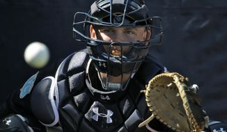 FILE - In this Feb. 19, 2016, file photo, New York Yankees catcher Brian McCann prepares to catch the ball during a spring training baseball workout in Tampa, Fla. The Astros added Carlos Beltran, Josh Reddick and Brian McCann this offseason. (AP Photo/Chris O'Meara, File)